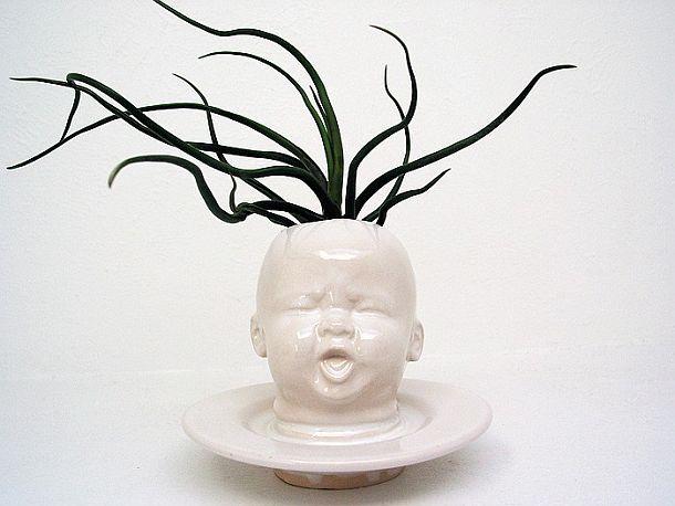 Цветочный горшок в форме детской головы
