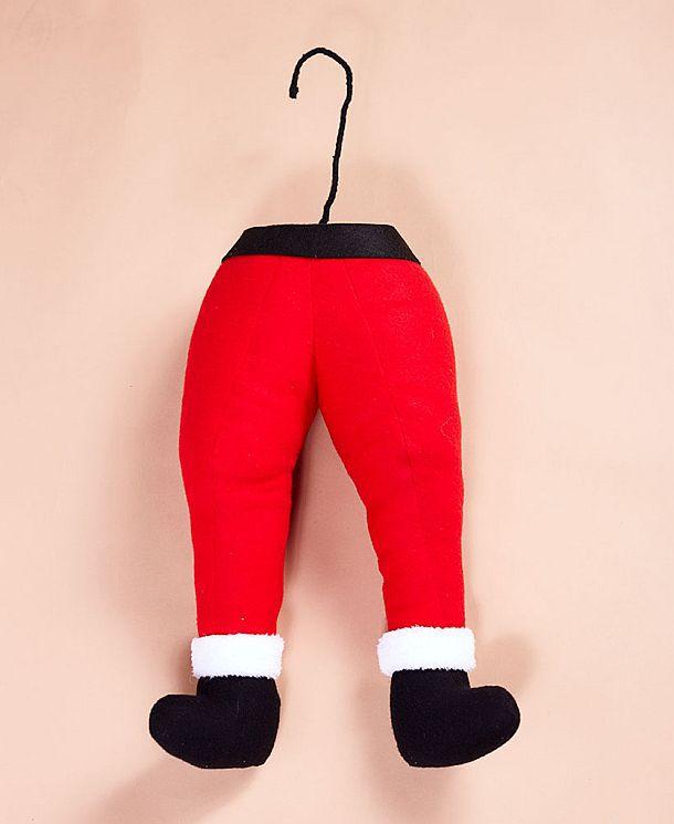 Игрушечные ноги эльфа и Санта Клауса